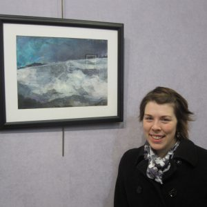 Katherine Horst with one of her collages at a recent solo show